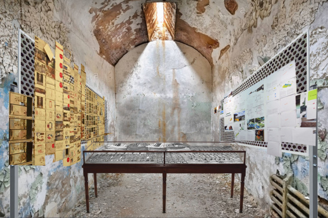 a prison cell in the eastern state penitentiary houses an art installation