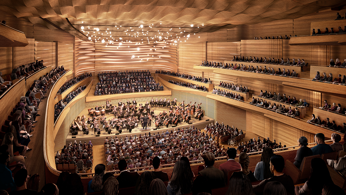 A render of a wood concert hall with curved forms and many people seated and the New York Philharmonic performing