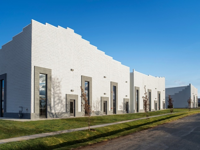 Squat, boxy buildings designed by Paul Andersen with an undulating roofline