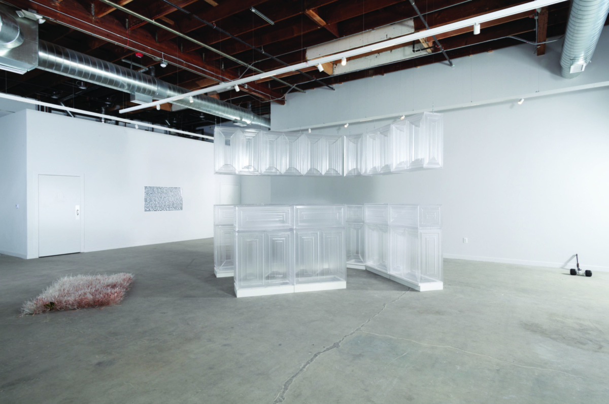 Interior view of gallery space with translucent sculpture in center