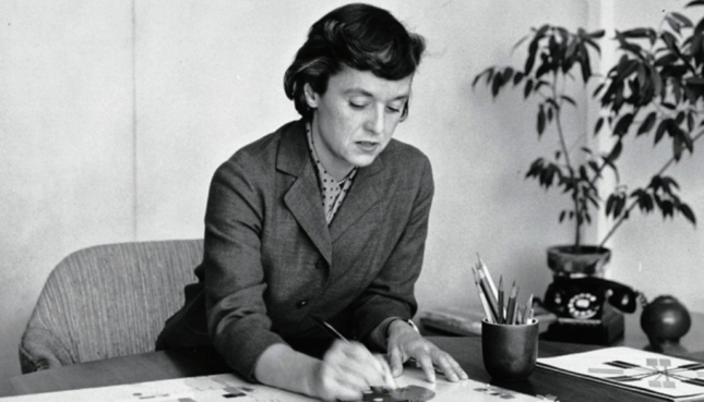 Black and white image of woman designing at a table