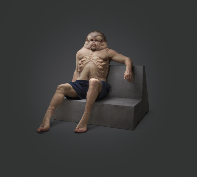 A wide, over-developed fake man on a couch