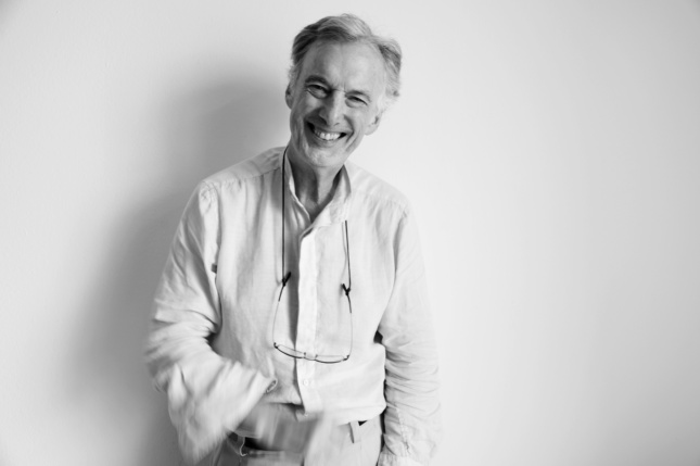 Black and white image of man smiling in white shirt