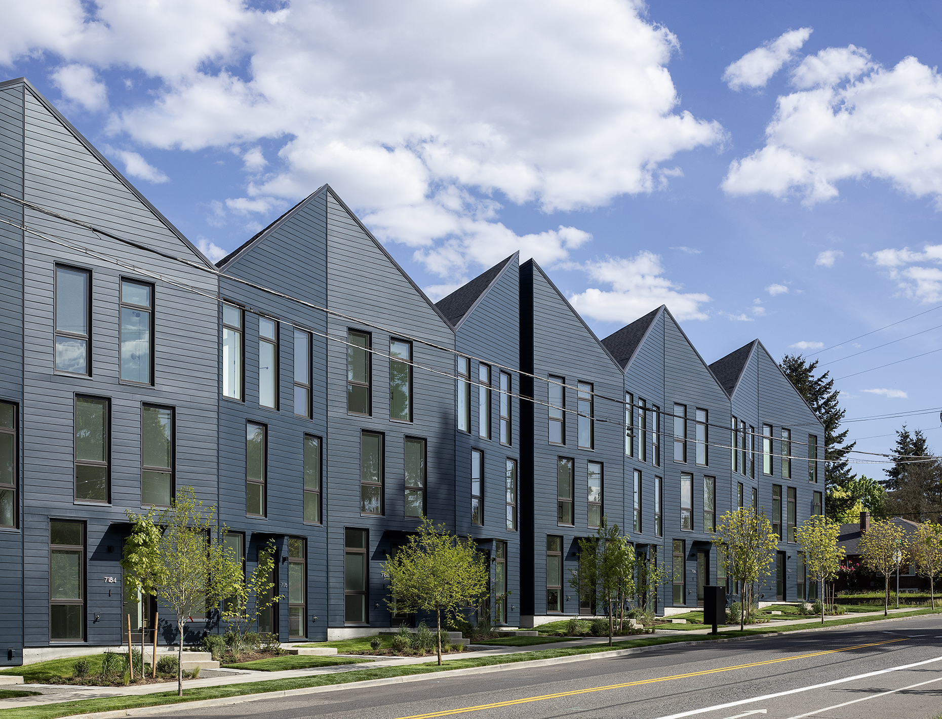 Exterior shot of origami-inspired townhouses in Portland clad in timber