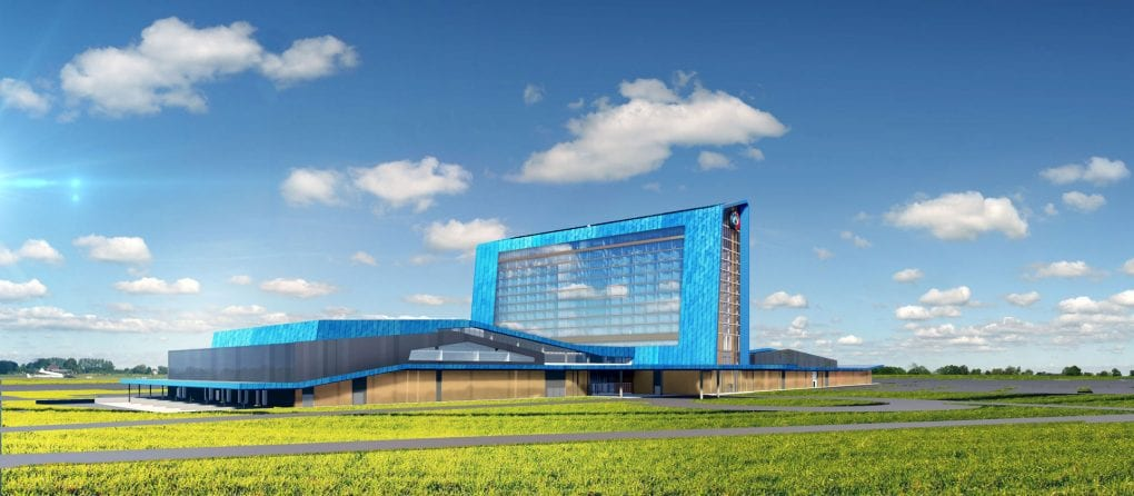 A rendering of bright blue Saracen Casino Resort in a grassy field