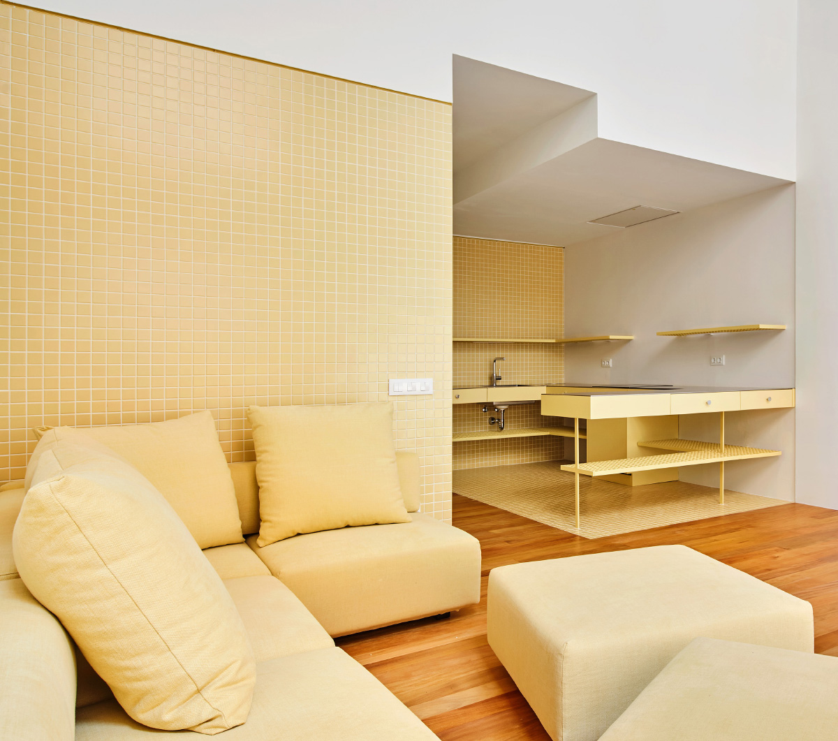Interior of an apartment complex with gold-tiled walls