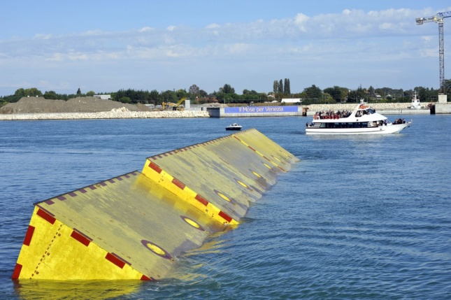 Photo of floating yellow flood barriers in the Venice Lagoon