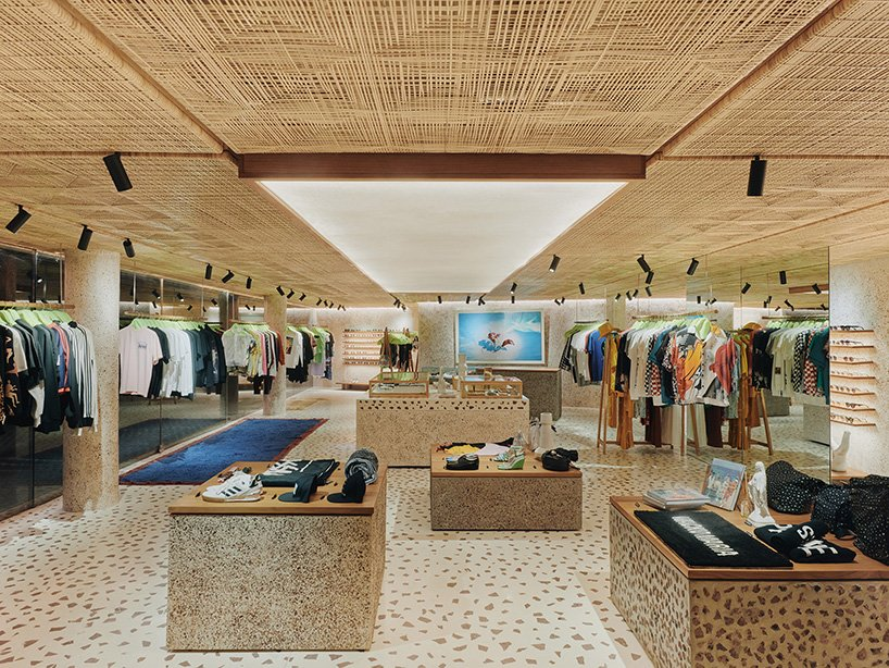Interior of a retail store with rattan panels and terrazzo flooring