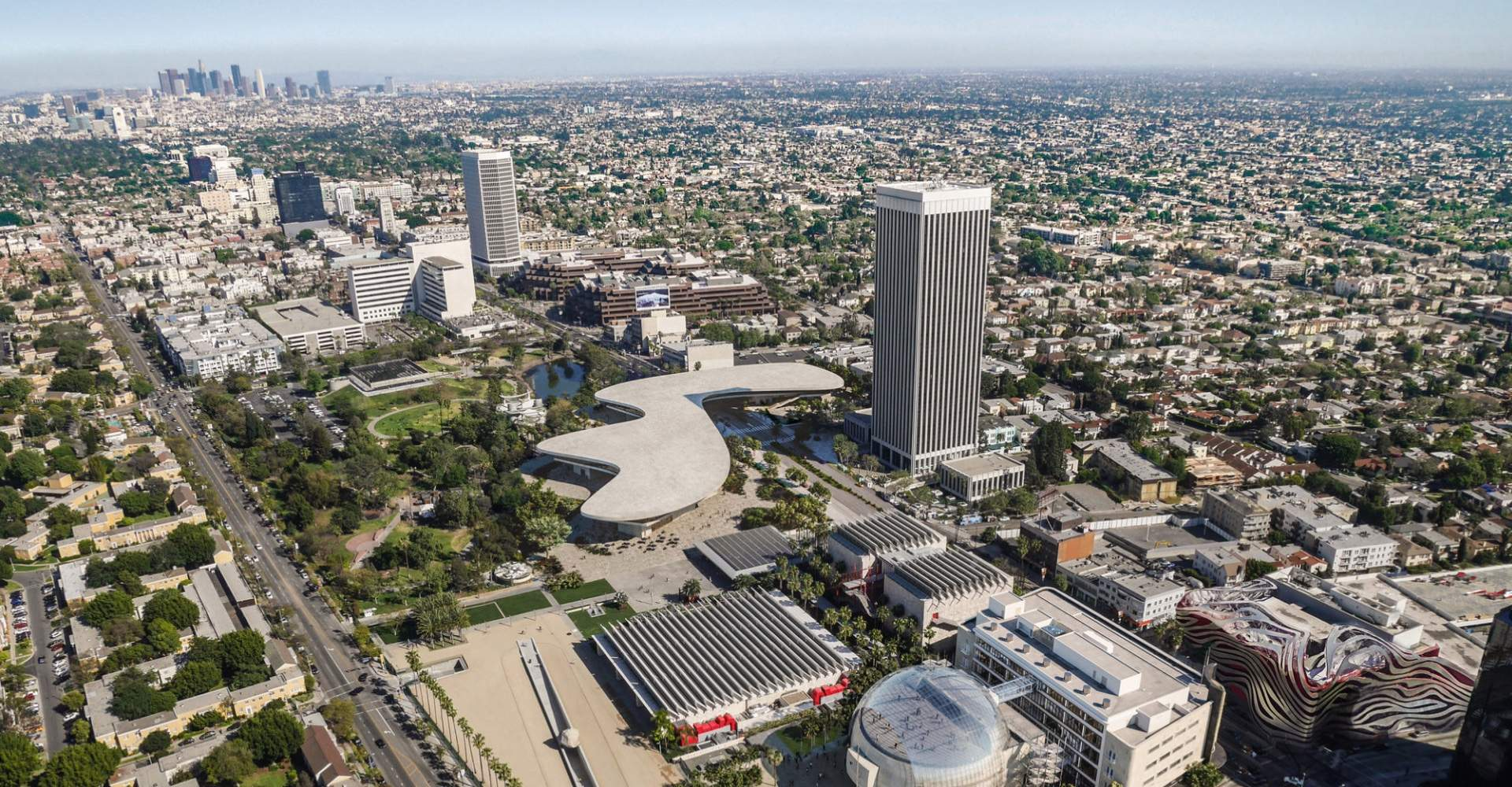 Aerial rendering of a large, flat, blobby-shaped building spanning an entire block, the new LACMA