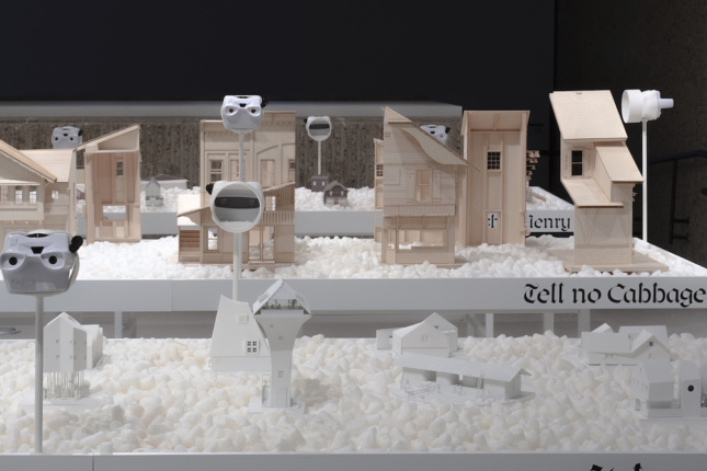 Installation view of Swissness Applied, showing white model buildings