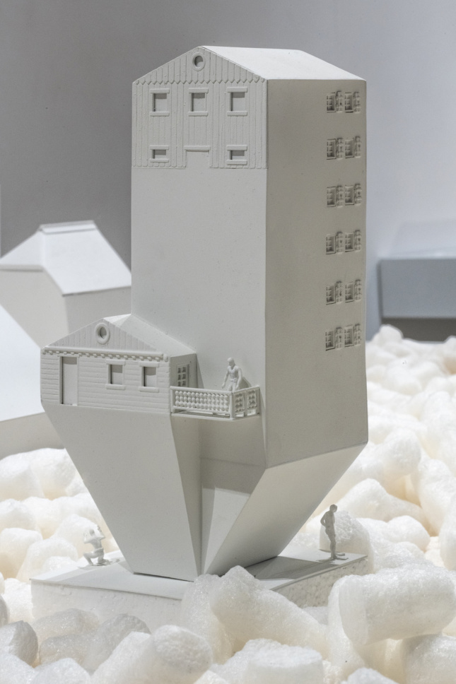 White model of a building sloping down at the bottom for Swissness Applied