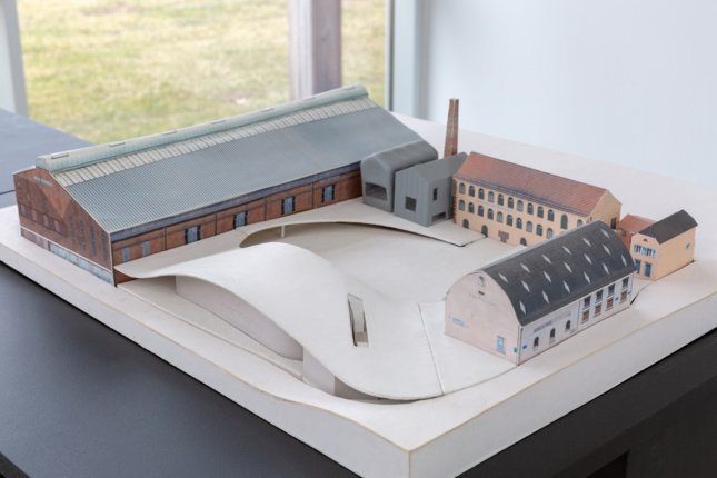 Model of a circular plan with multiple buildings at Art Omi