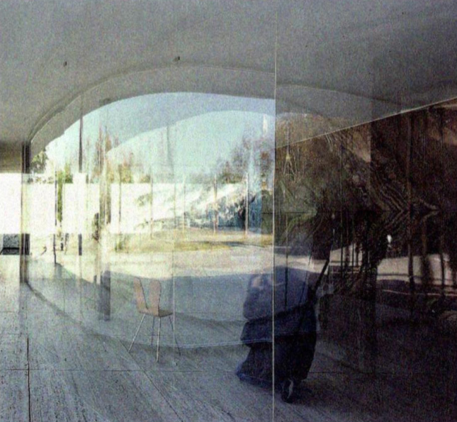Photograph of curved clear walls in an enclosed pavilion