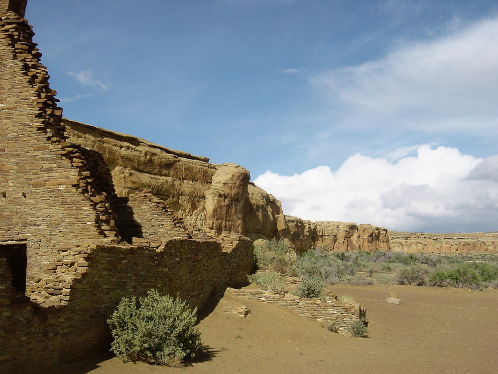A curved rock formation in the desert