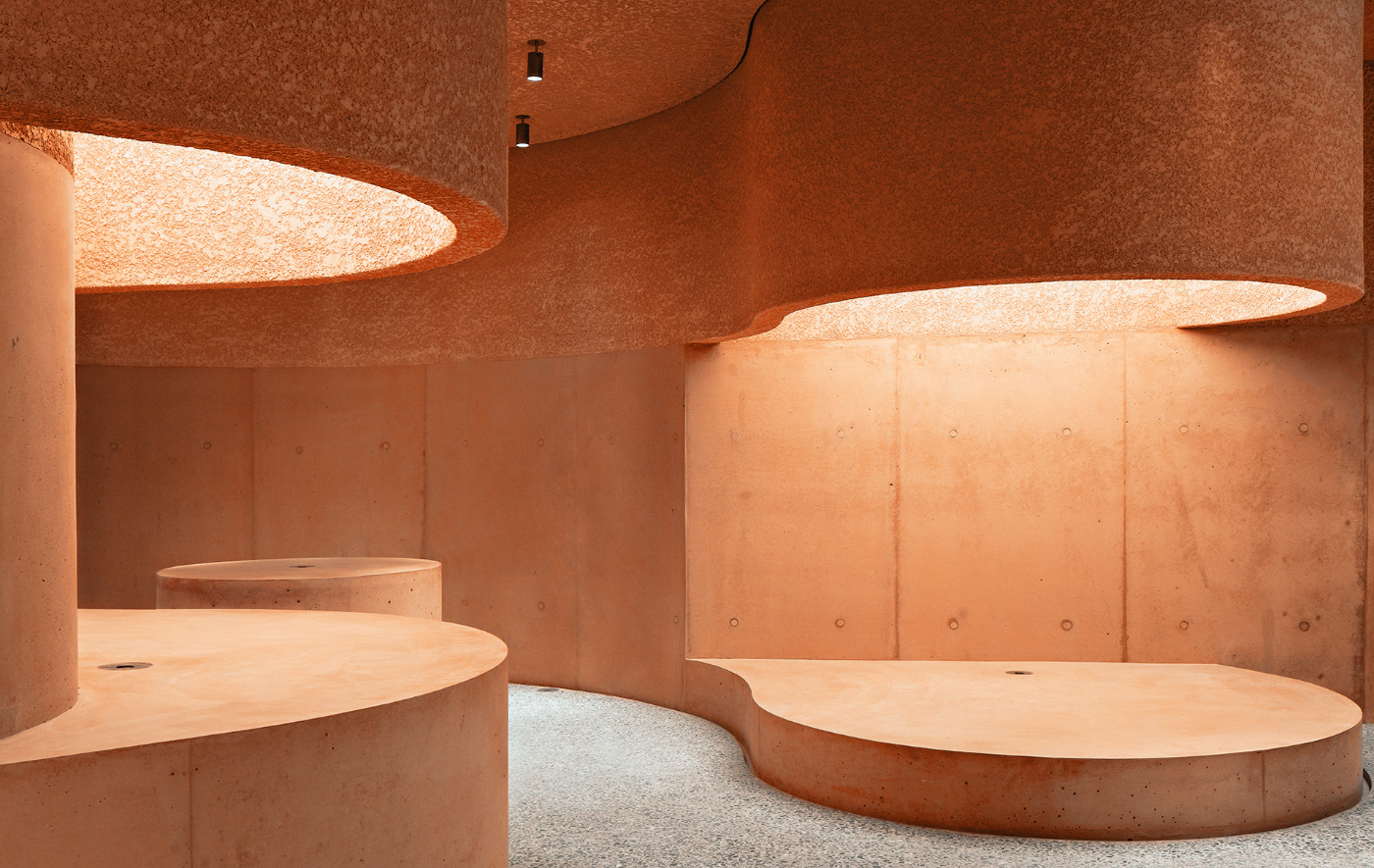 Interior of a pink concrete retail store for The Webster