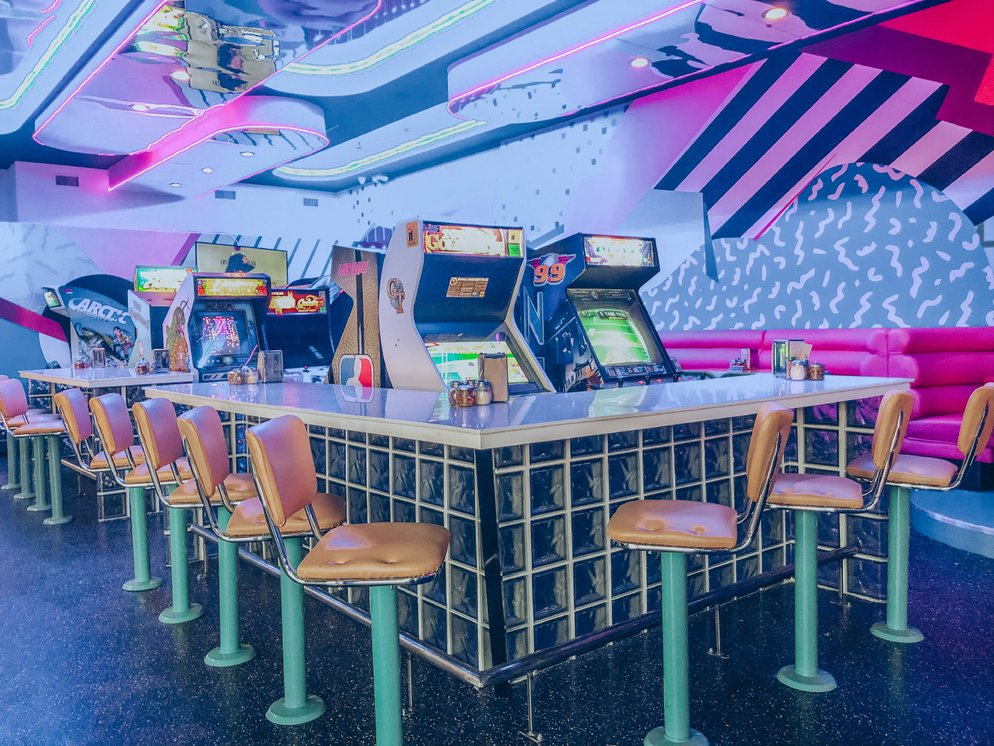 A neon-drenched pizza parlor