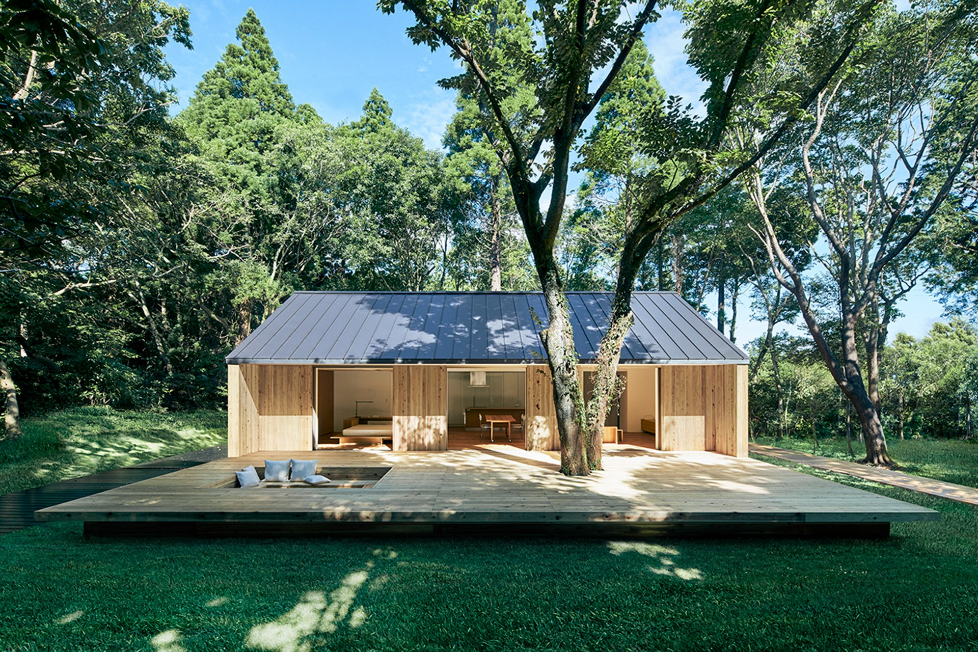 Exterior photo of a short, gabled house designed by Muji