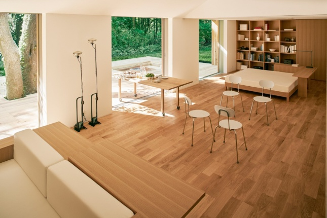 Looking out into a living room with wood furniture