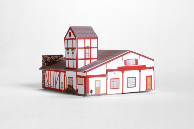 A paper model of a Tudor-style house in Swissness Applied