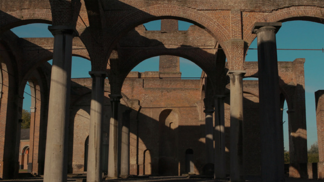 Video still of brick arches from Fiona Tan