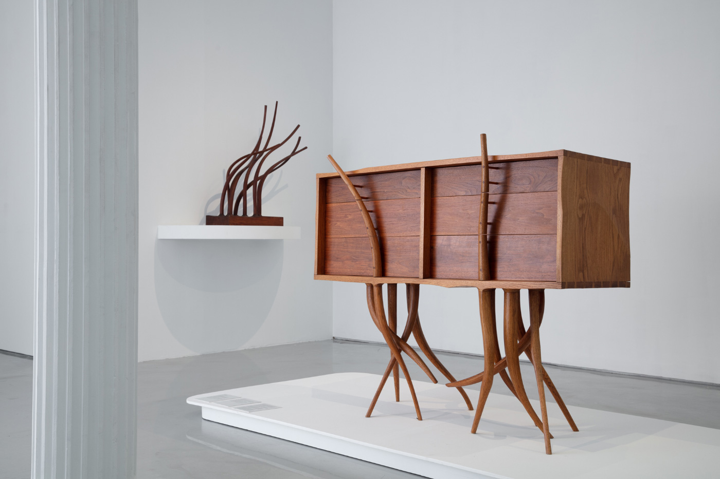 A Wendell Castle-designed dresser with branches for legs