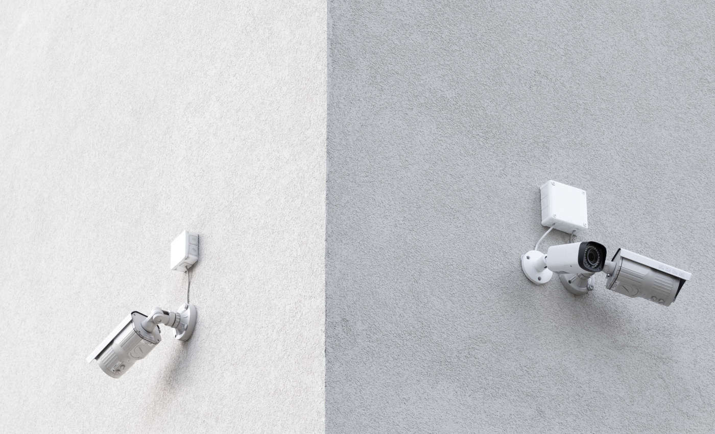 Photo of two surveillance cameras on a wall