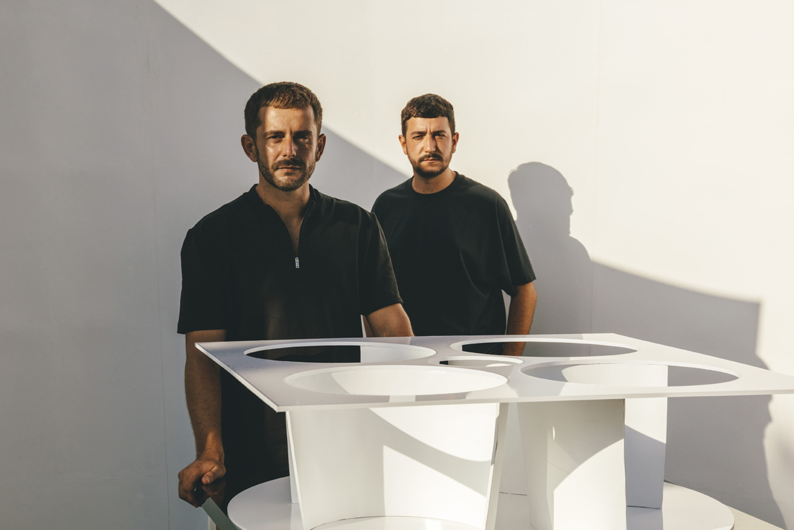 Two men, MUT Design, at a table