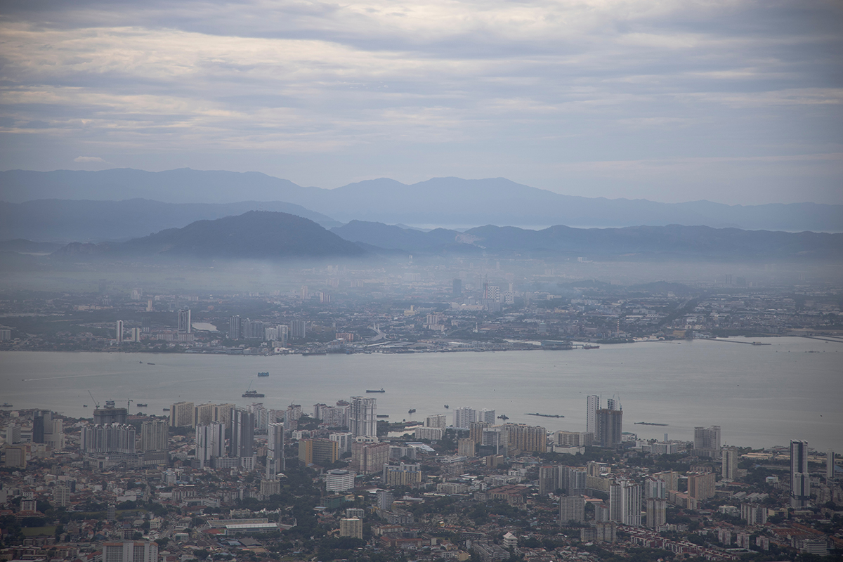 Aerial and foggy view of Penang by the sea, the site of the new artificial islands