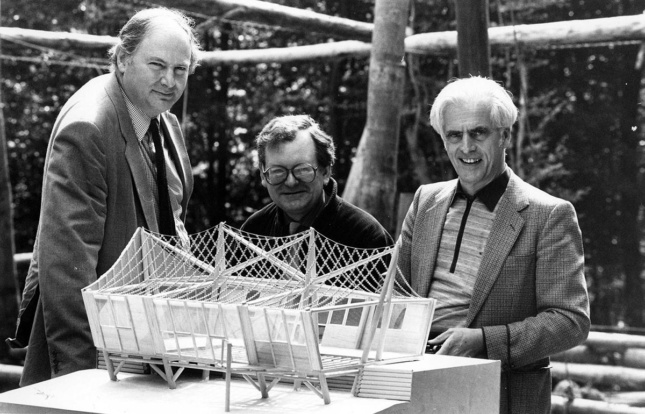Richard Burton, John Makepeace, and Frei Otto posing with timber structure model