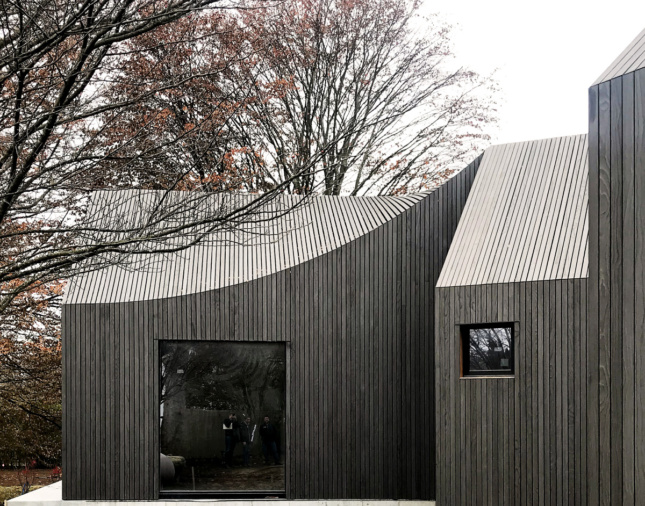 A sloping wood home designed by an Emerging Voices winnter