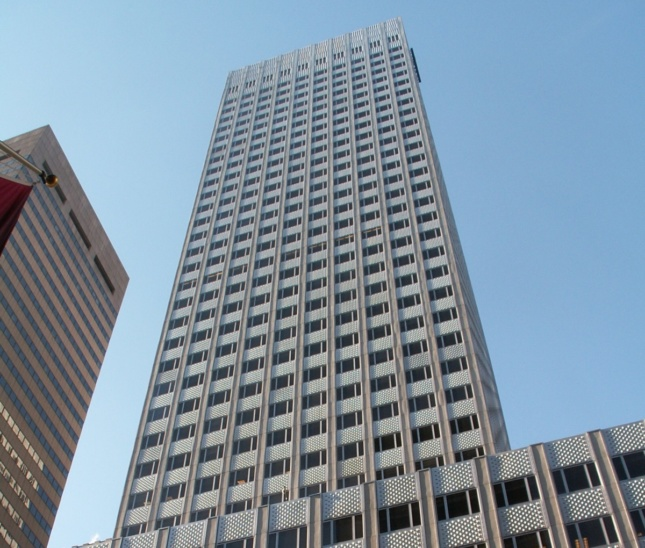 Photo looking upwards at midcentury office tower with thick aluminum cladding