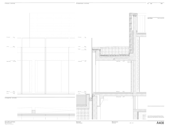 Section of facade wall detailing large blocks meeting glass panels