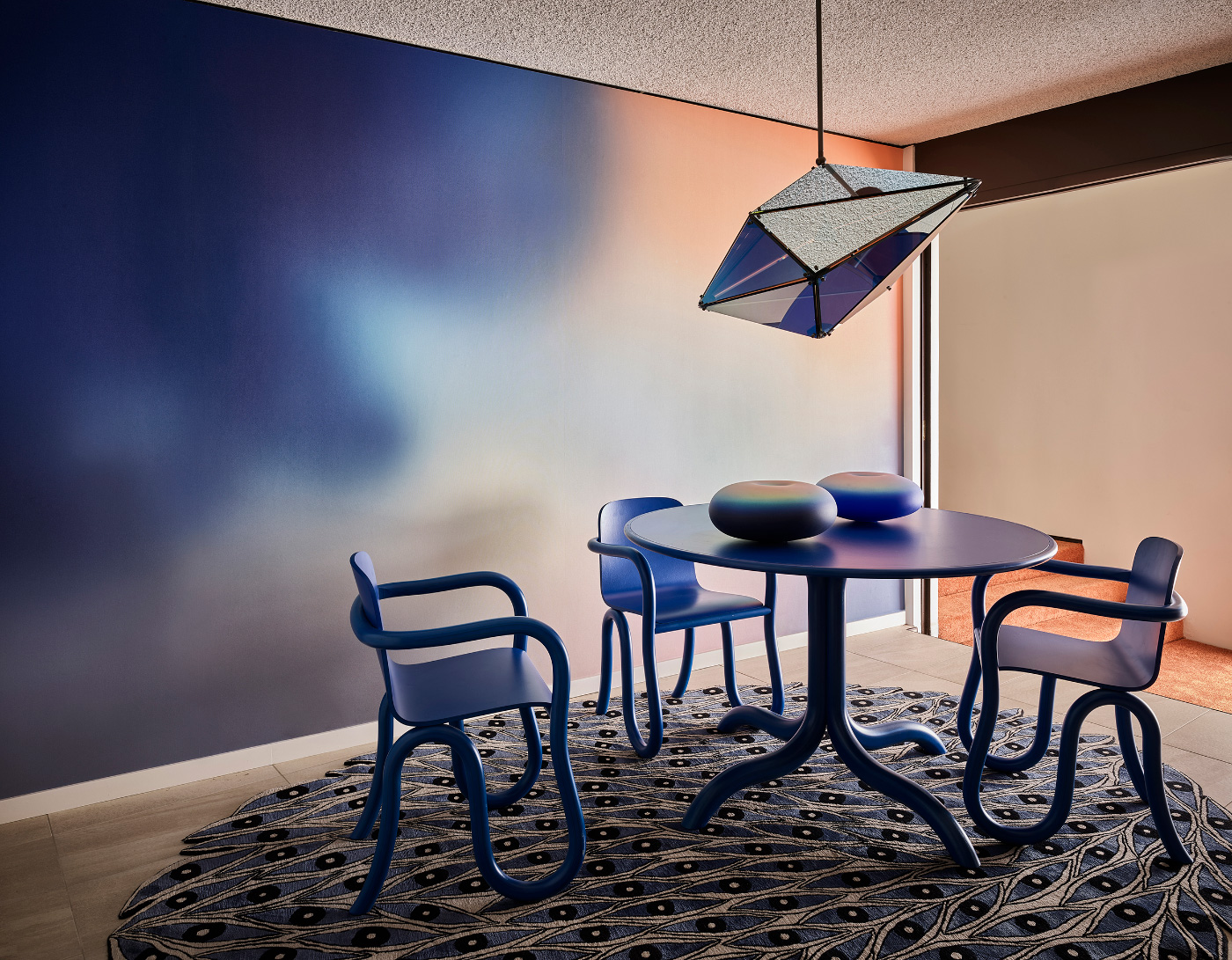 Interior of a Future Perfect showroom showing a blue wall and geometric lamp