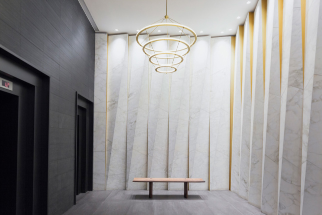 Interior photo of a lobby decked out in pleated marble