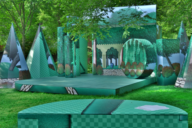 An outdoor theater with green furniture designed by T+E+A+M