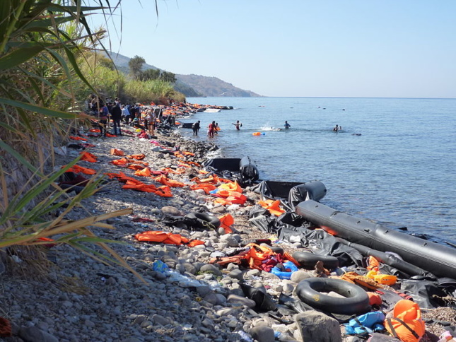 a lifejacket-littered beach in Lesbos, Greece