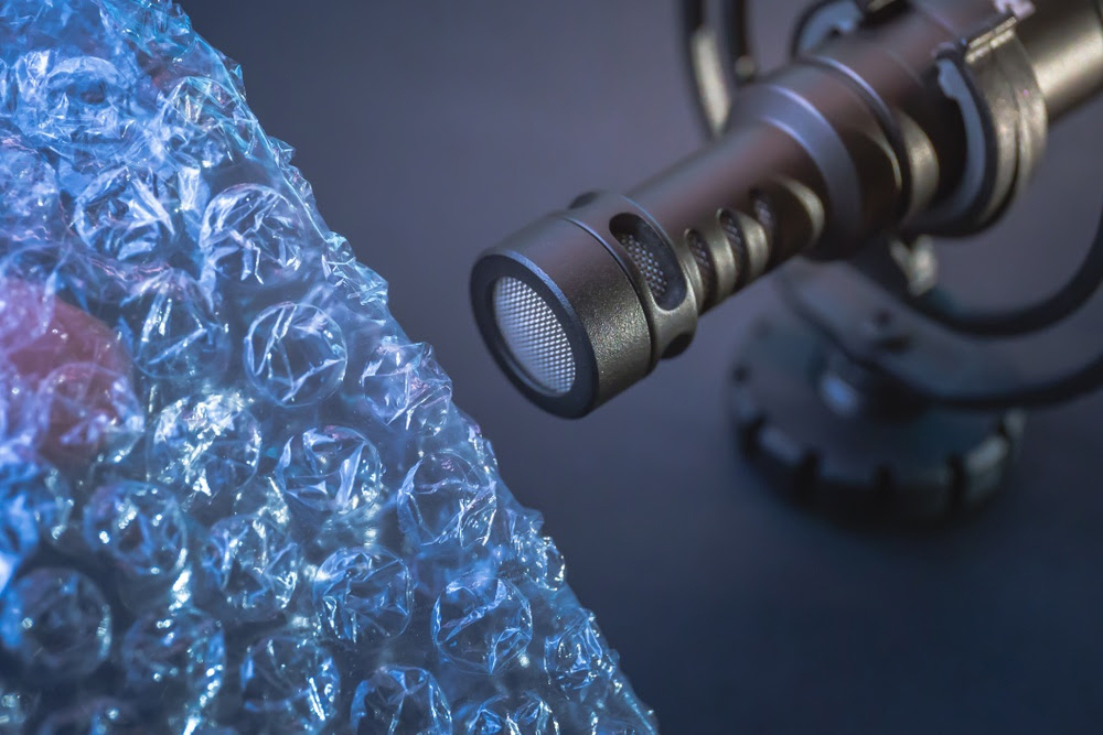 Bubble wrap in front of a microphone as part of an ASMR setup