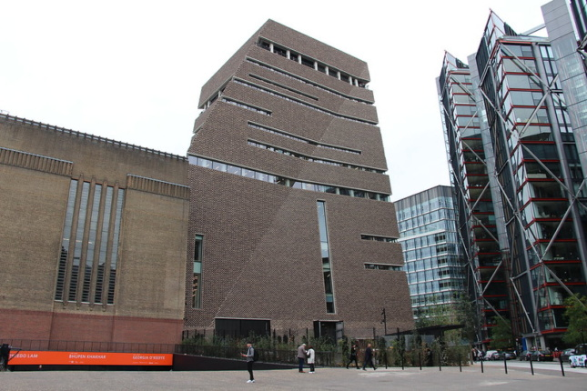 The Neo Bankside and Tate Modern; a blocky, angular brick building next to a glass tower, respectively