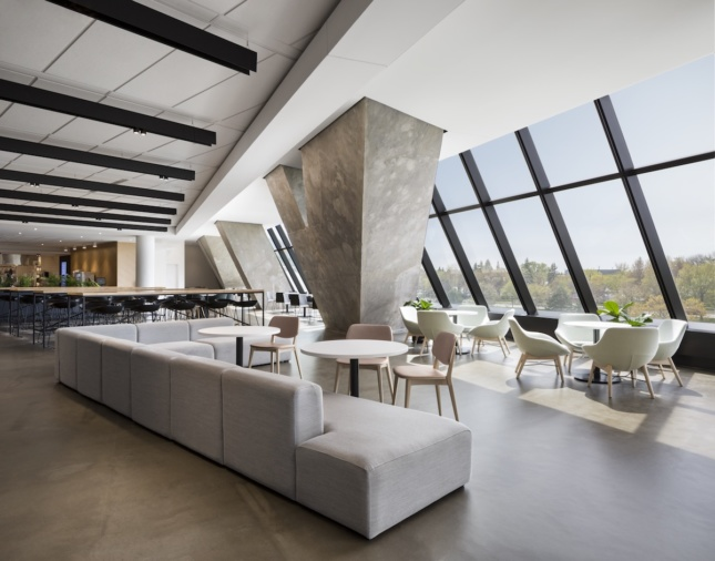 Dining area and lounge at Montreal's converted Olympic Tower, showing large exposed concrete structural elements