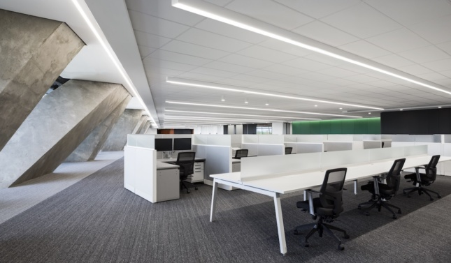 workspace inside Montreal's renovated Olympic Tower, showing white desks on a full floor