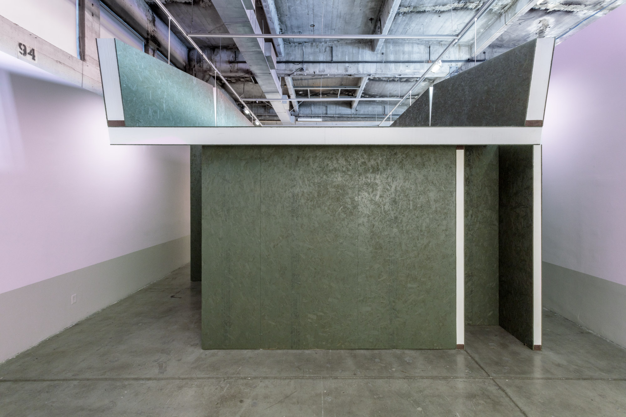 dark grey structure in gallery space