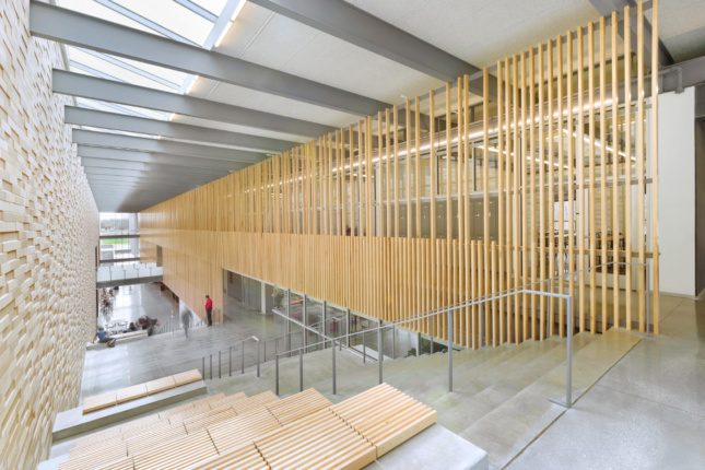 Interior photo of a school with a timber screen