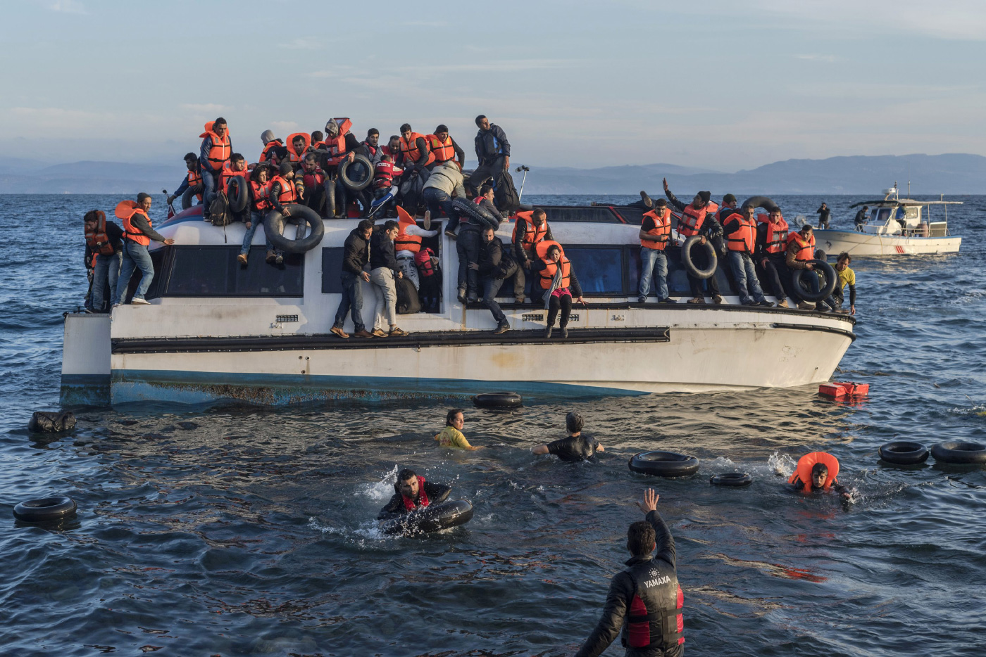 Refugees arrive by boat in Greece's Aegean Islands