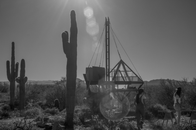 A photo of students erecting a tent in the desert of Taliesin