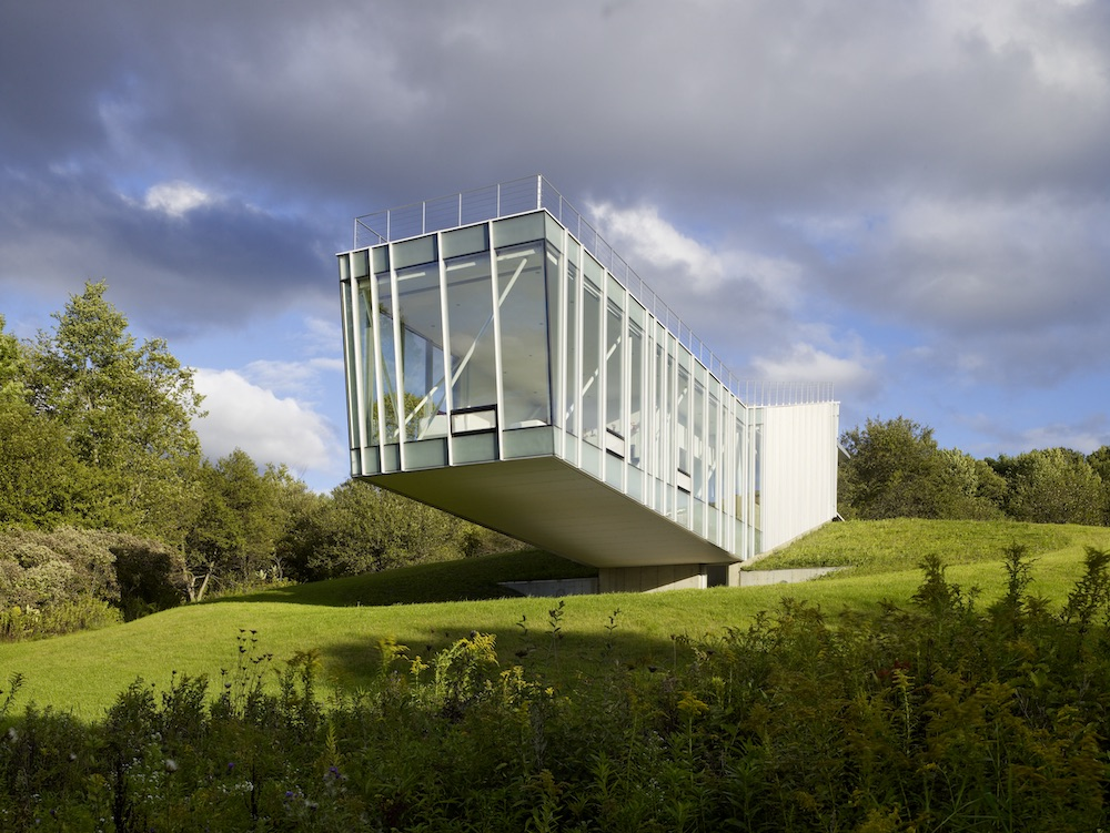 a cantilevered house in a rural landscape