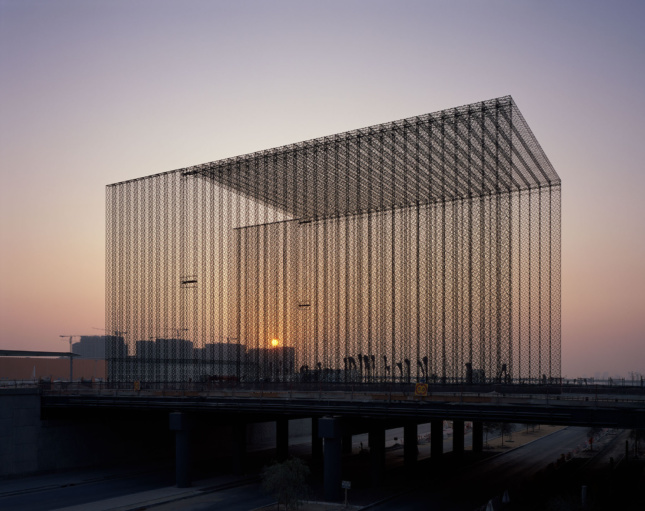 Photo of a large, barn-shaped freestanding lattice for Expo 2020