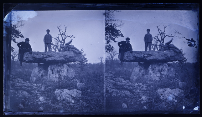 two identical purple photos of people on a rock structure