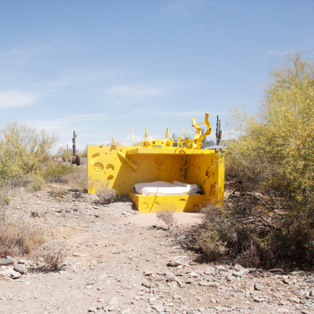 A yellow structure in the desert