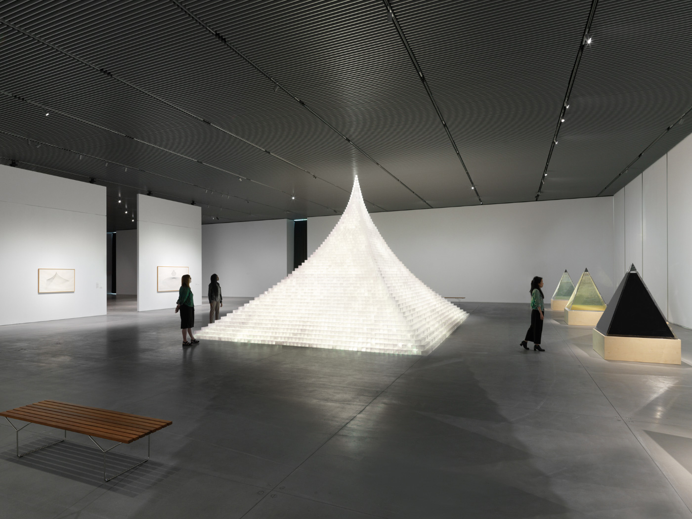 A glowing pyramid in a massive arts space, now closed due to coronavirus
