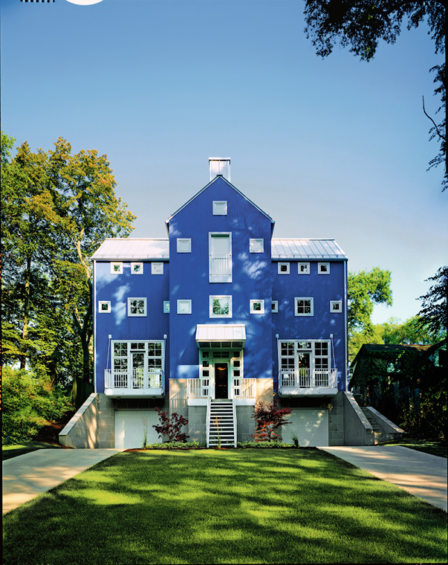 a postmodern house painted in blue